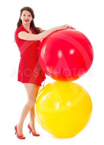 Beautiful woman in red dress with two big red and yellow...