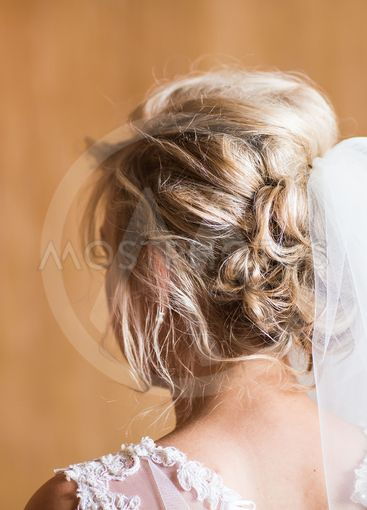 Beautiful bride with fashion wedding hairstyle close-up