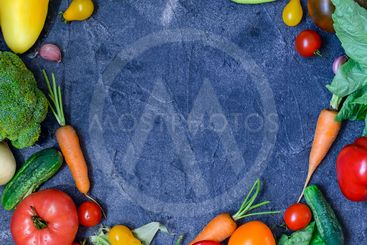 Frame of organic food. Fresh raw vegetables and greens on...