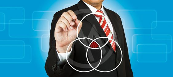 Businessman drawing intersected circle diagram and shadow...