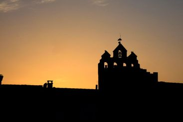 Church of Saintes-Maries-de-la-Mer in france at sunset