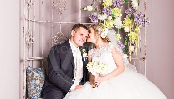 Wedding couple indoors is hugging each other. Beauty...