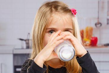 Little girl child drinking milk kid glass healthy eating