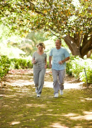Couple running in the wood