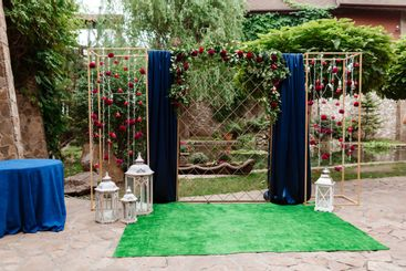 wedding arch. decorated white chairs at a wedding ceremony
