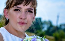Pretty young girl holding a posy of flowers