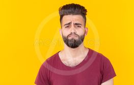 Sad young handsome man hipster with a beard in a...