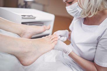 Pedicurist doing professional medical pedicure procedure...
