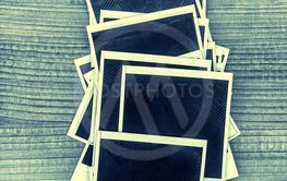 Retro style instant photo frames on wooden background