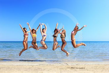 Group of Six Attractive girl jumping on the beach