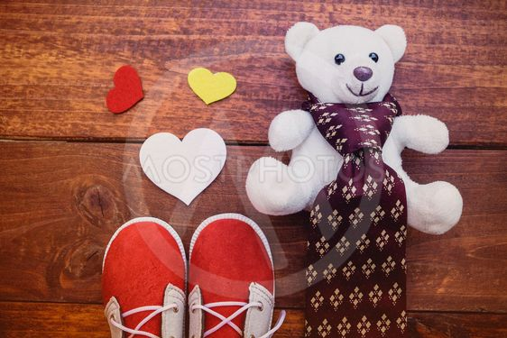 Red shoes son with white teddy bear and necktie