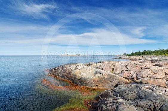Rocky coastline in vivid colors during a beautiful summer...
