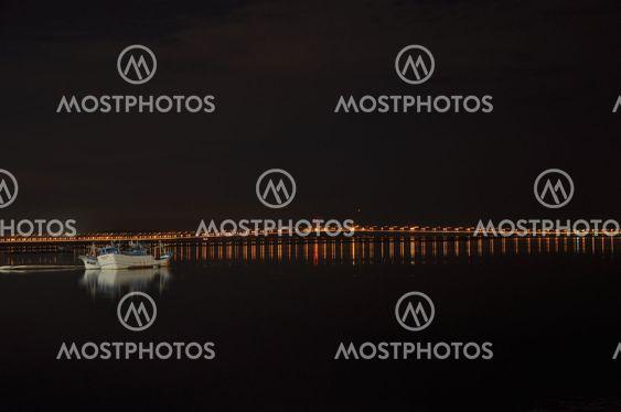Boat with Penang Bridge at night