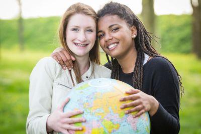 Multiracial Girls Holding Globe Map