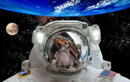 Astronaut in outer space against the backdrop of the...