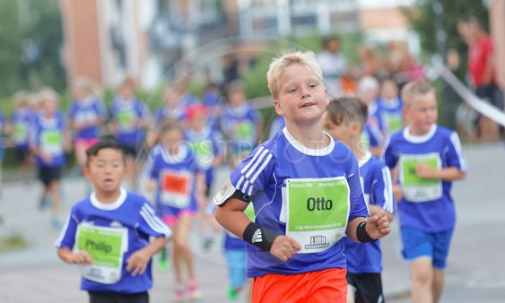 Young blonde boy running