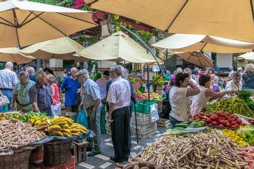 Customers buying fresh vegatables at famous market...