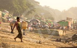 Burmese woman working in slum