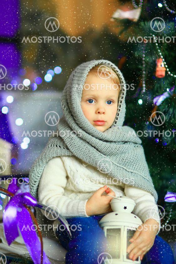 the girl near a Christmas fir-tree 11