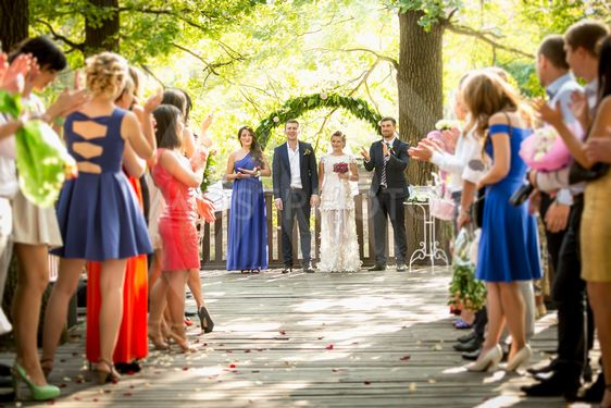 outdoor wedding ceremony at park with lot of guests