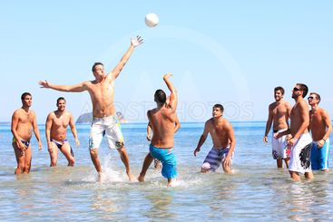 Group of male friends by the sea