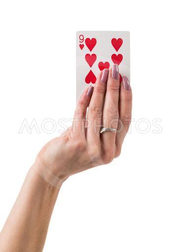 Female hand showing nine hearts card
