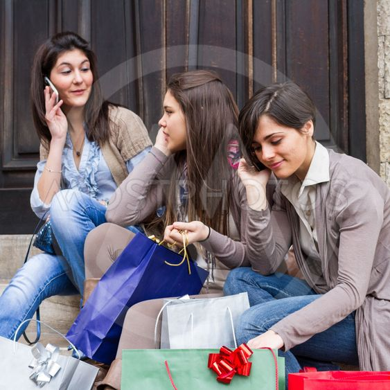 Group of Women Talking on Mobile Phone