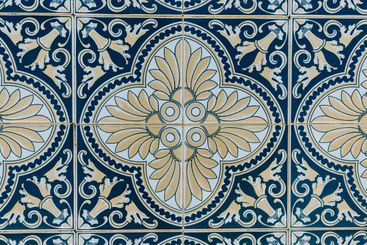 Background made of a portuguese tile with a mosaic in it