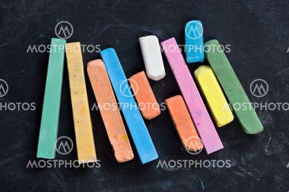 blackboard with coloured crayons