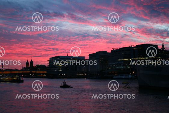 Night shot of London on the river Thames at sunset, the...