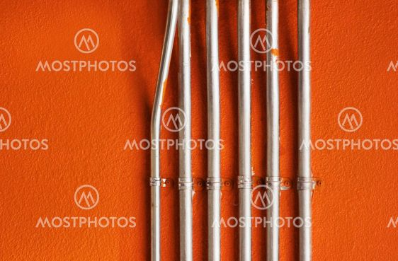 Pipes on an Orange Wall