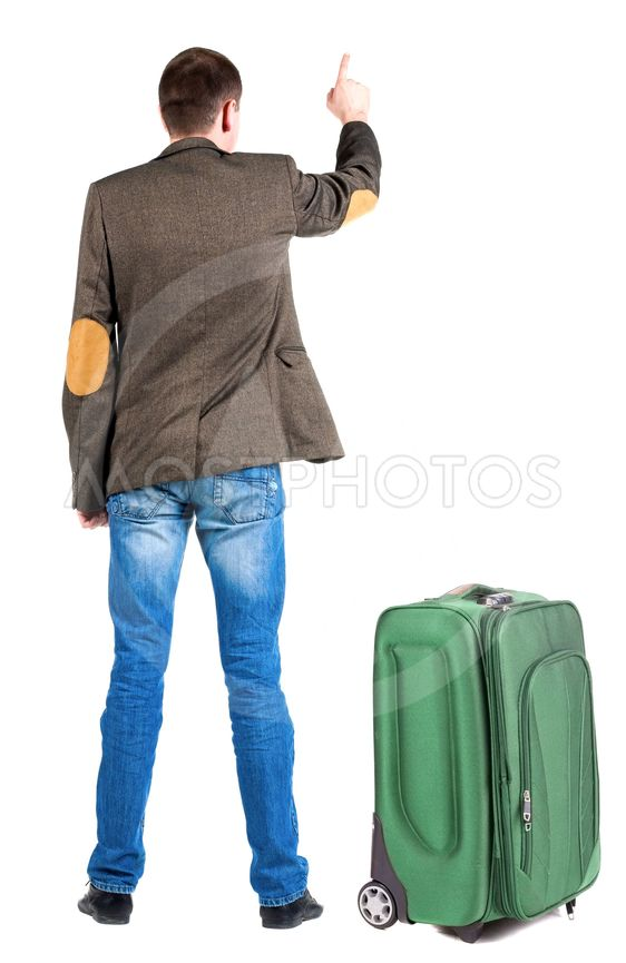 Back view of pointing business man in jacket traveling...