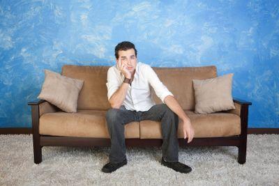 Bored Man on Sofa