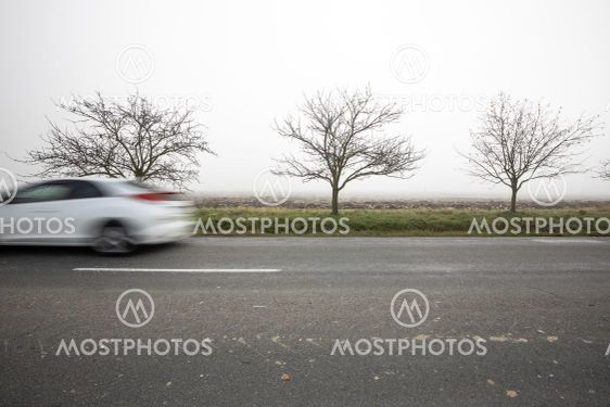 Motion blurred truck going fast on a rural road