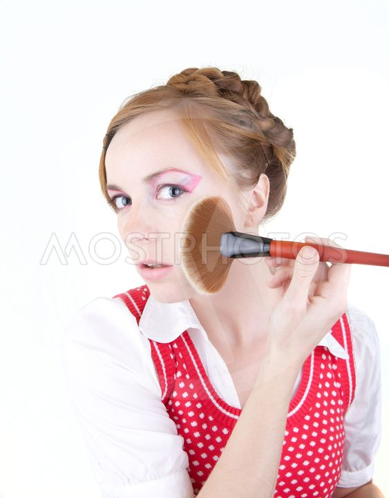 Girl with cosmetics brushes