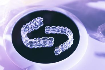 Invisible aligners teeth retainers lie on the mirror