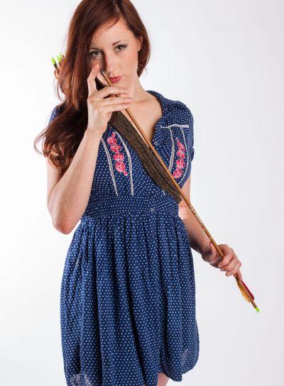 Female Archer Examines Arrow Point