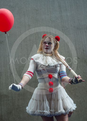 sexy bad girl posing with red balloon at the geek cosplay...