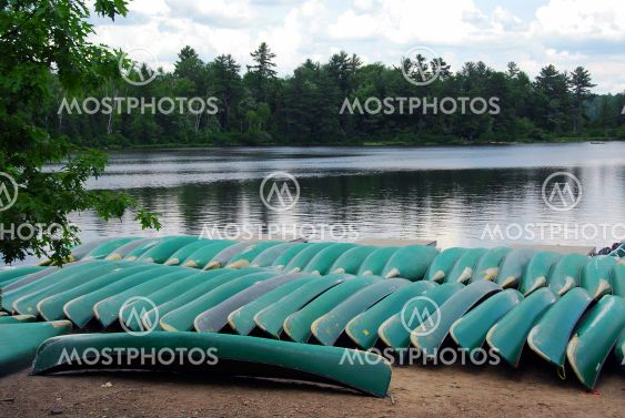 Canoes on lake shore