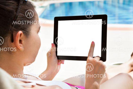 Woman Using Digital Tablet At Resort