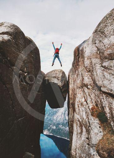Man jumping over Kjeragbolten Travel in Norway