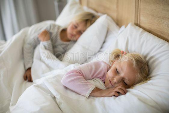 Girl sleeping in the bedroom