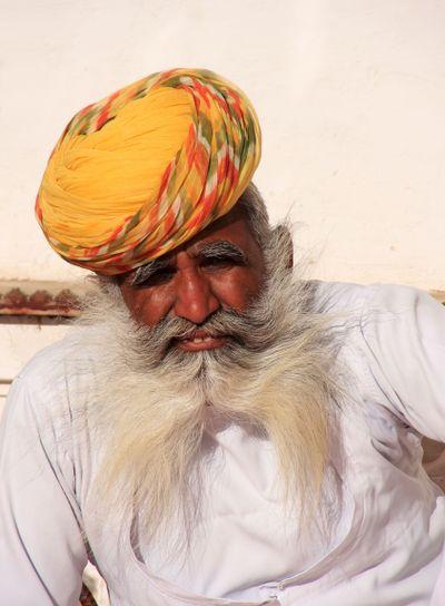 Indian man sitting at Mehrangarh Fort, Jodhpur, India
