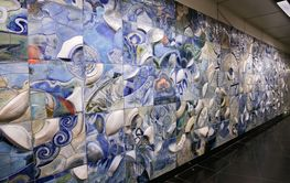 Wall made from tiles with relief and multicolored...