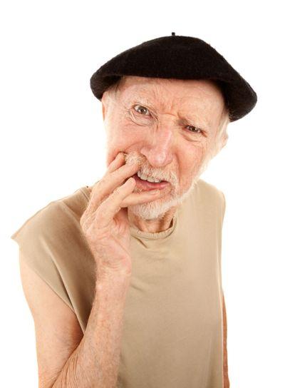 Confused senior man in beret