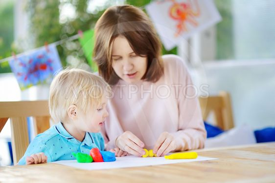 Cute little boy drawing and painting with colorful...