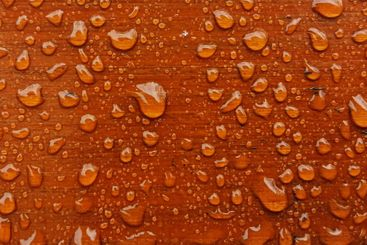 Wet background of a wooden bench with water drops