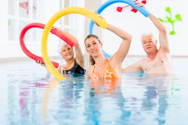 Group in aquarobic fitness swimming pool