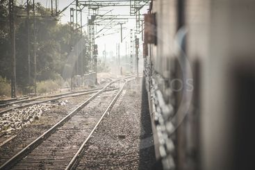 Walking between tracks with trains in india