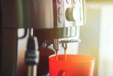 Close-up coffee machine making fresh coffee in the...